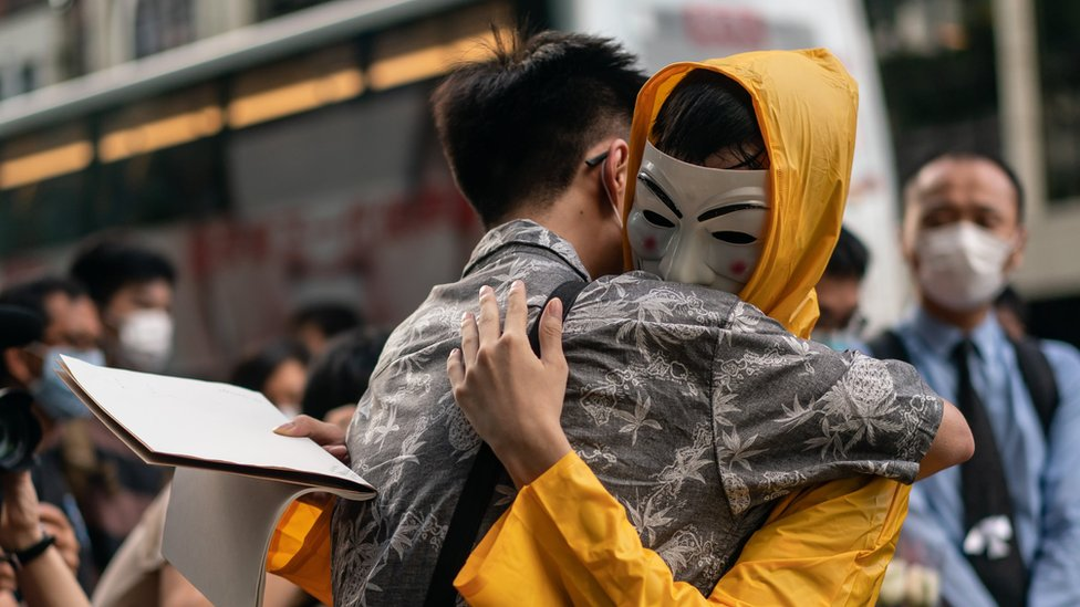 5: Mourners embrace during the one-year anniversary memorial vigil to commemorate Marco Ling-kit Leung at a shopping mall on June 15, 2020 in Hong Kong, China.