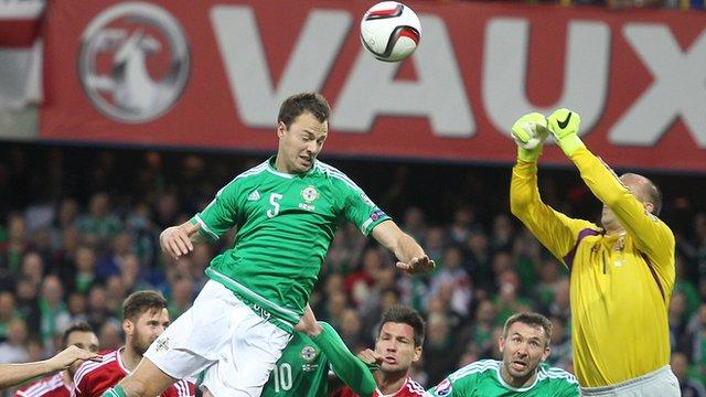 Jonny Evans rises highest to head on goal against Hungary at Windsor Park
