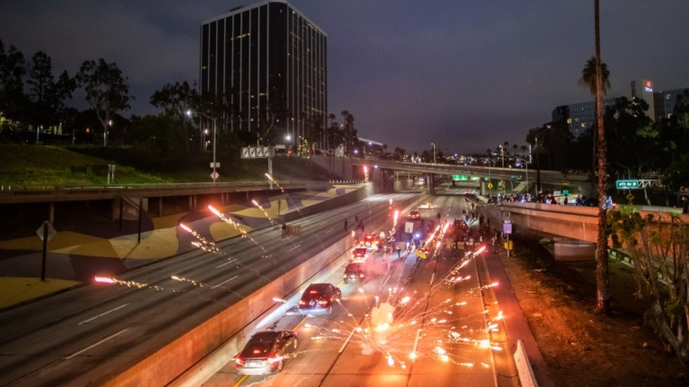 Fireworks were thrown on to Freeway 110 North, in Los Angeles, as protesters tried to block roads