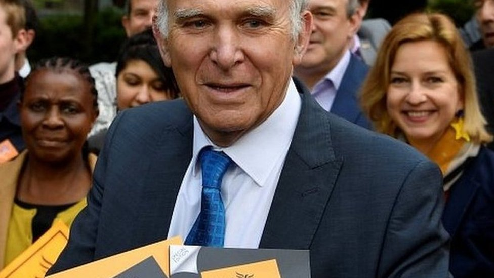 Sir Vince Cable holds the party's European election manifesto at a campaign event in May