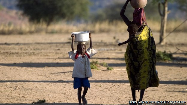 Refugees collecting water