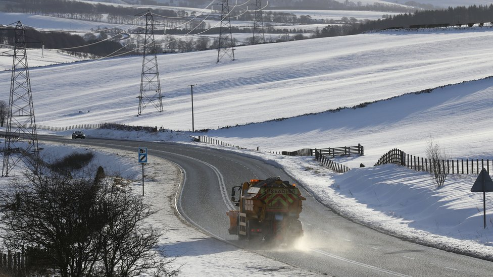 A gritter lorry on a road in Scotland