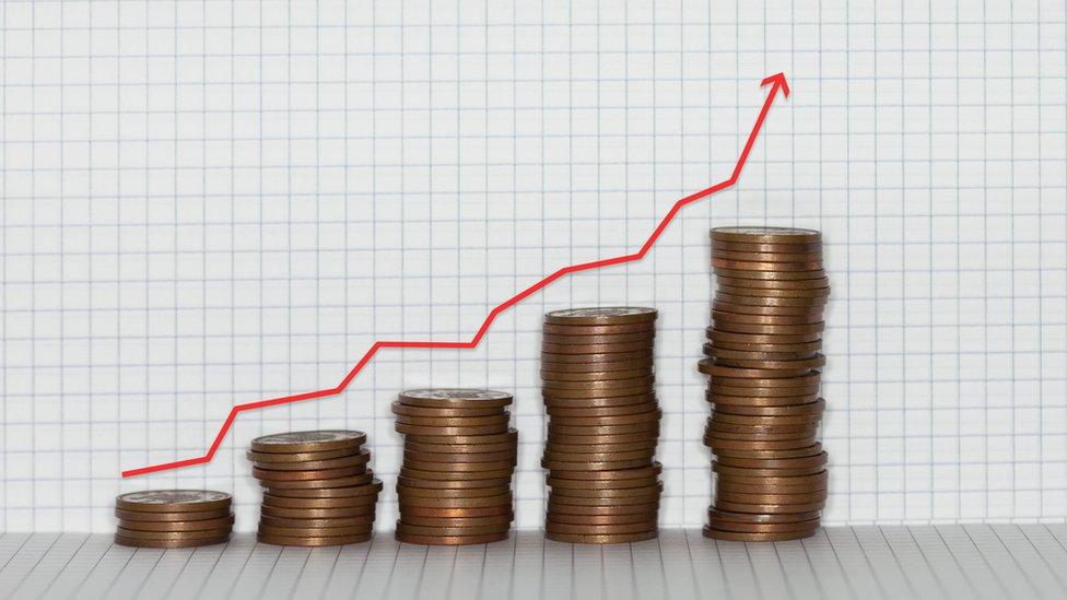 Gráfico con monedas para representar la inflación.