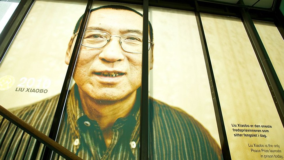 A picture of the 2010 Nobel Peace Prize Laureate Liu Xiaobo is seen at The exhibition ?Be Democracy? at The Nobel Peace Center on October 11, 2014 i