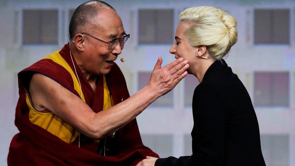 The Dalai Lama greets Lady Gaga