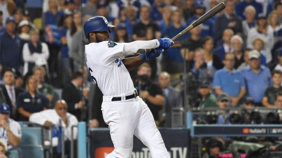 Los Angeles Dodgers outfielder Yasiel Puig swinging