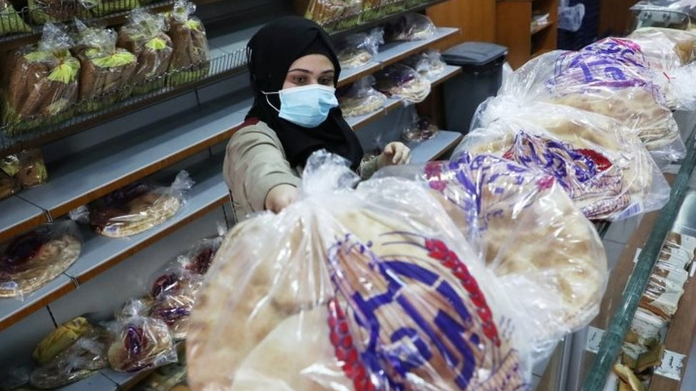 A vendor arranges bread for sale in a bakery in Beirut, Lebanon. Photo: 7 December 2020