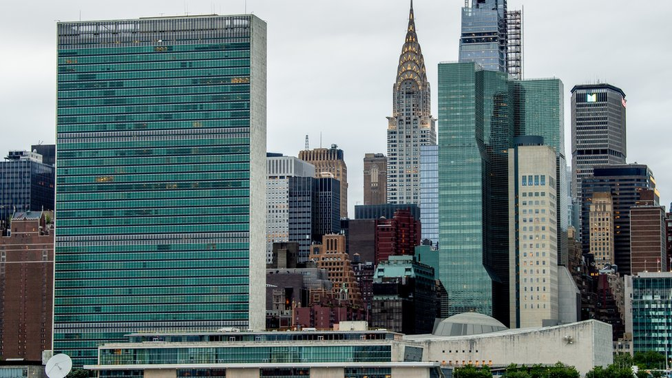 A view of the UN Headquarters and Chrysler Building behind it, as seen from the Gantry Plaza State Park in Long Island City on 23 May 2020 in New York