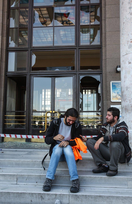 Survivors of blasts in Ankara sit on the steps of the railway station, Turkey - Saturday 10 October 2015