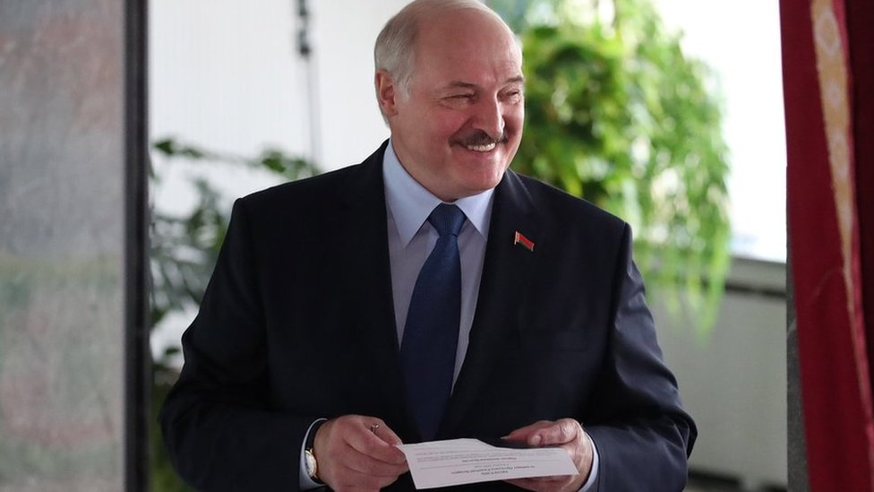 Belarusian President Alexander Lukashenko votes during the presidential elections at a polling station in Minsk, Belarus, 09 August 2020.