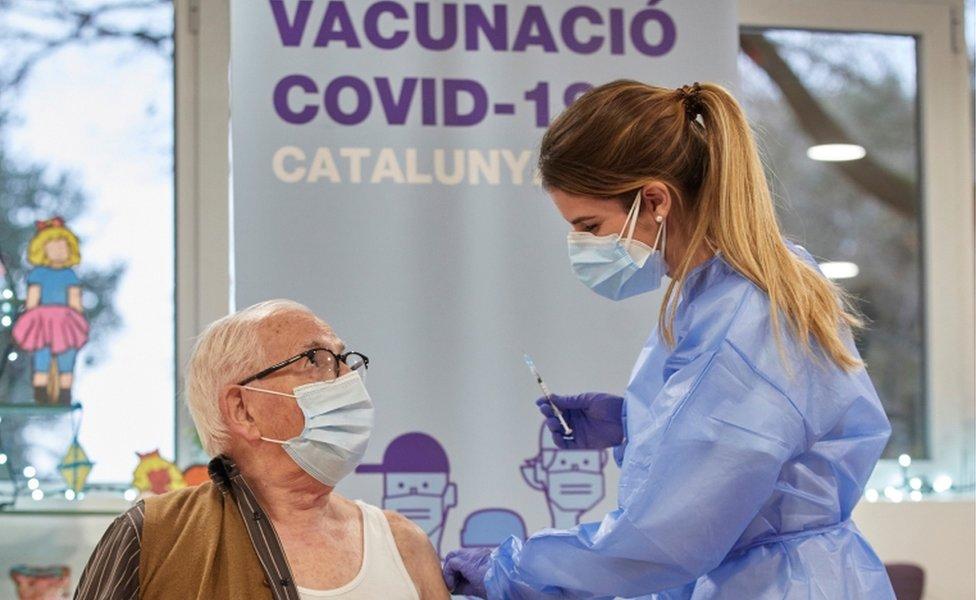 An elderly person receives the coronavirus disease vaccine at resident Gent Gran Creu, in Girona, Catalonia, Spain, 27 December 2020
