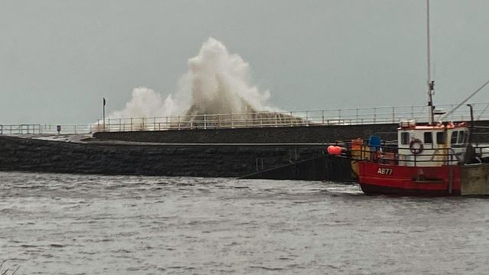 Waves crash on the front at Aberystwyth