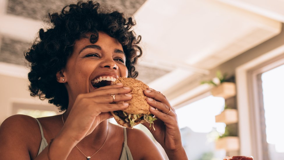 Woman eating a burger