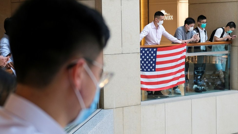 A pro-democracy demonstrator wearing a face mask holds a U.S. flag during a protest against new national security legislation in Hong Kong, China June 1, 2020.