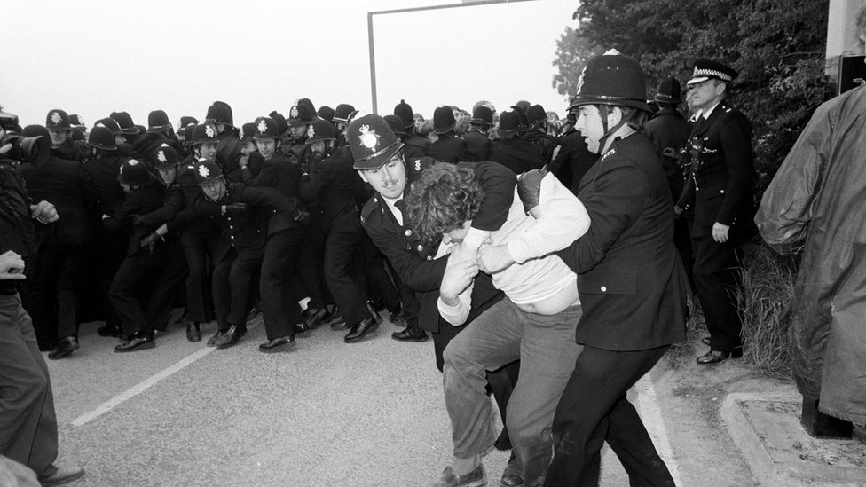 Police grapple with a picket as police lines other pickets back at Gascoigne Wood drift mine near Selby