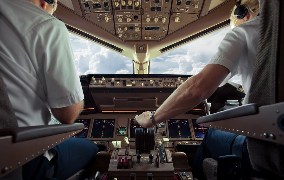 pilots in plane