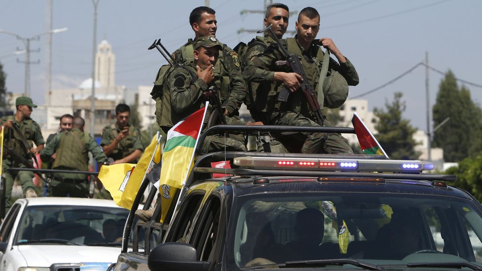 Members of the Palestinian Authority security forces patrol the West Bank city of Nablus on 19 August 2016