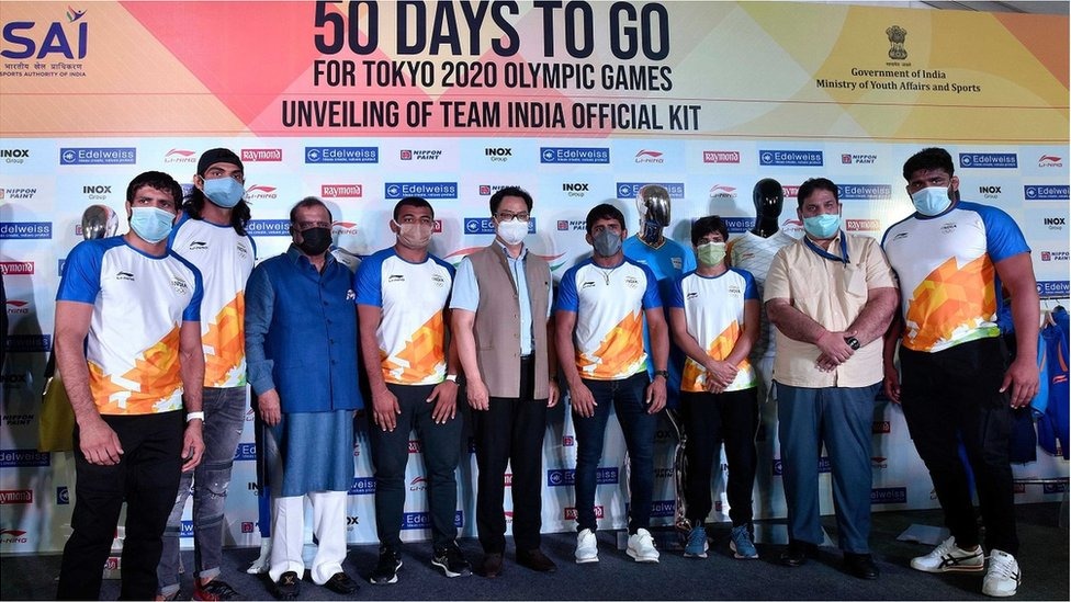 Union Sports Minister Kiren Rijiju along with Indian Olympic Association Boss Narinder Batra and Olympic players and officials during the launch of Team India kit for the Tokyo 2020 Olympics Games, on June 3, 2021 in New Delhi, India