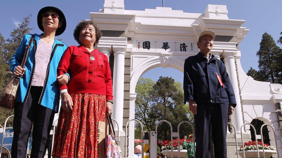 Alumni take photos in Tsinghua University in Beijing on April 24, 2011. Tsinghua University celebrates its centenary anniversary today. 24APR11 Photo by Simon Song
