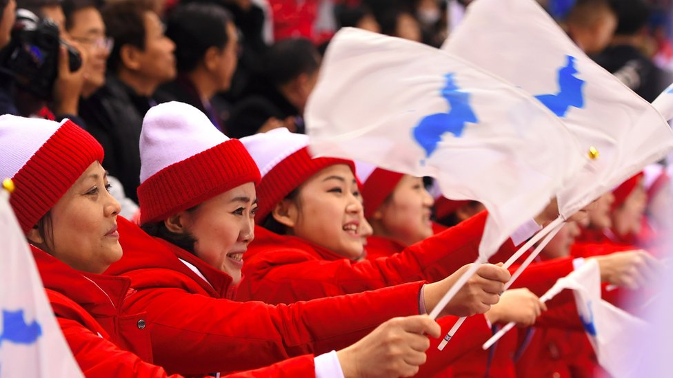 North Korea's cheerleaders hold the Unified Korea flag during the 2018 Winter Olympics
