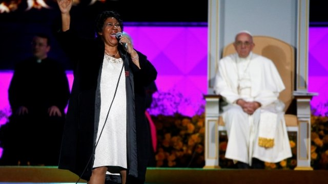 Pope Francis listens as Aretha Franklin performs on stage during the Festival of Families