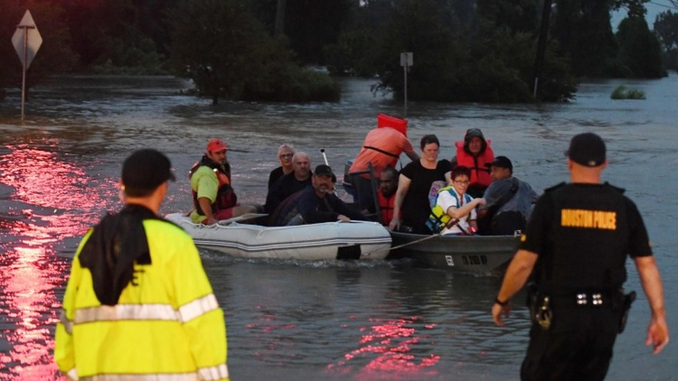 Victims are rescued by boat in Houston