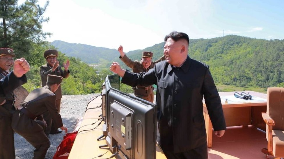 North Korean leader Kim Jong-un (right) reacts during the test of the Hwasong-14 missile in this undated photo released by North Korea's KCNA news agency on 4 July 2017