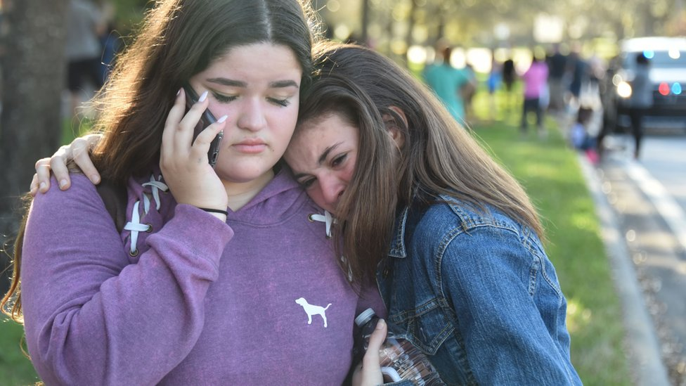 Two students hug each other after the shooting
