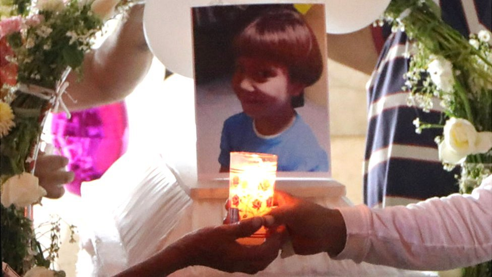 People light candles near the coffin of Fátima Aldrighett, 7, who went missing in Mexico City, 17 February 2020