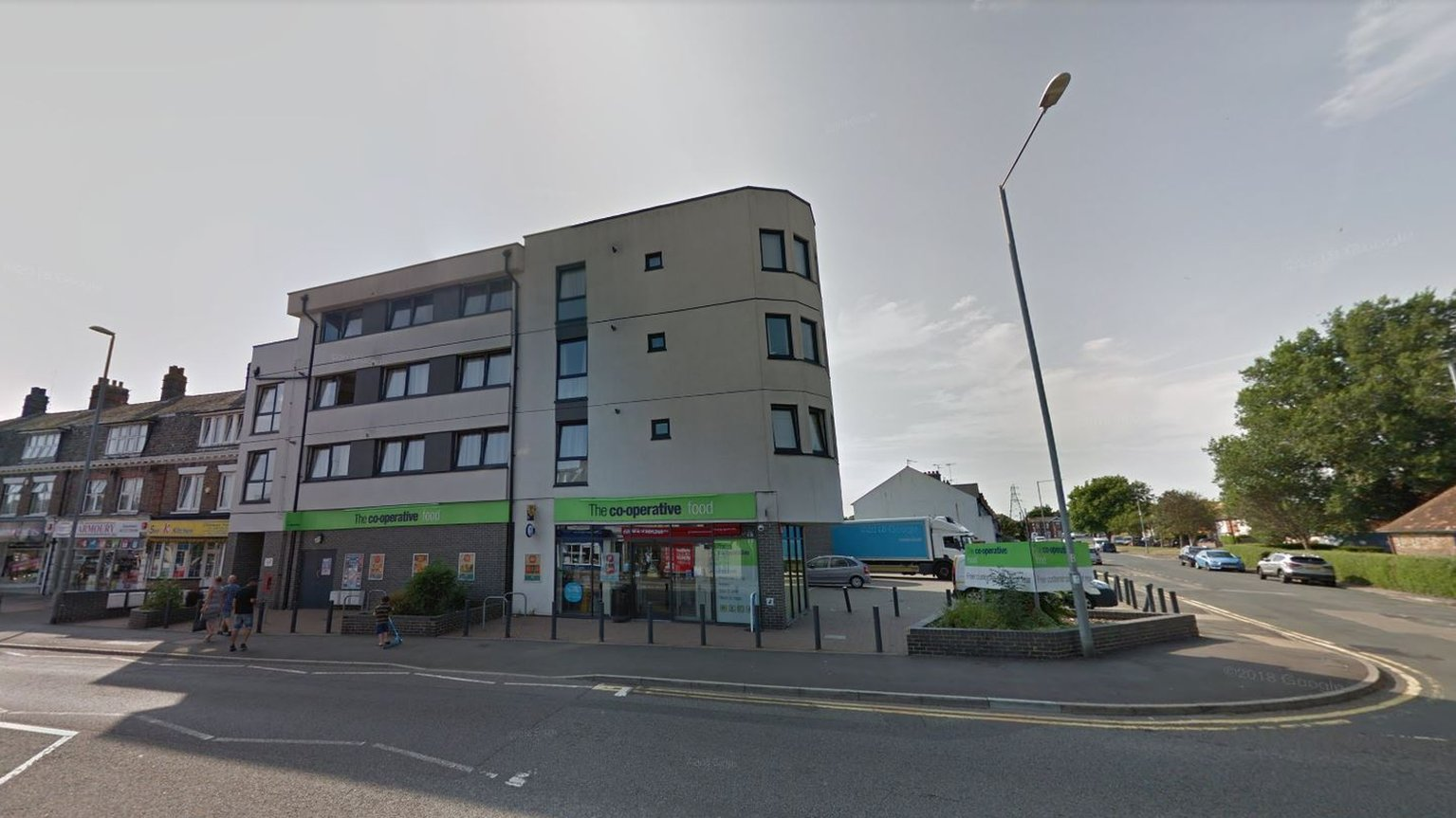 Co-op worker threatened with hammer in Eastbourne raid