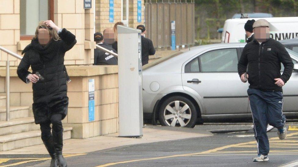 Two other gunmen flee the scene