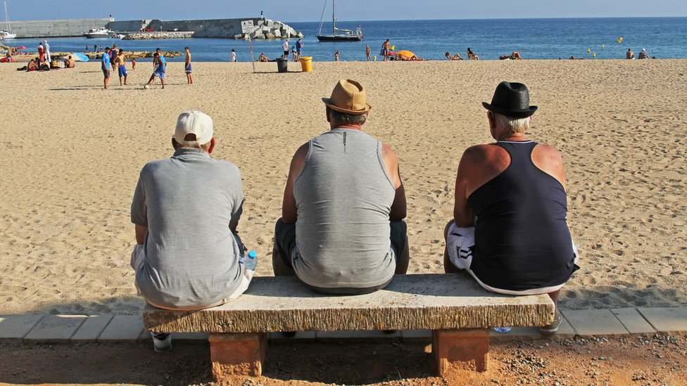 Men looking out at the sea in Spain