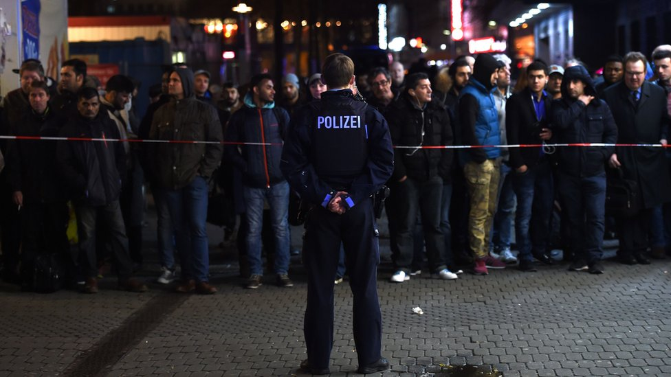 Policemen secure the area around a train station after an axe attack on passengers at the main train station on March 9, 2017 in Duesseldorf, Germany