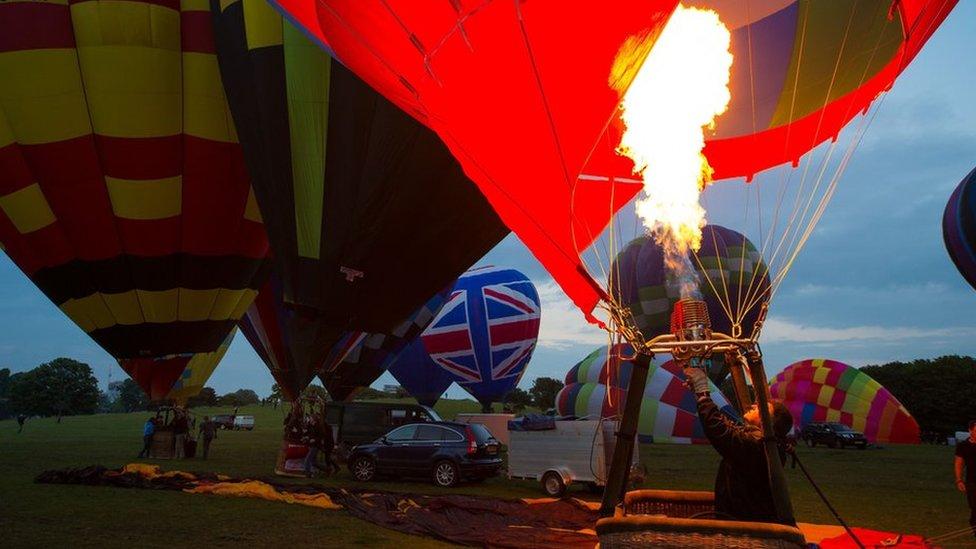 Balloon pilot prepares for take-off