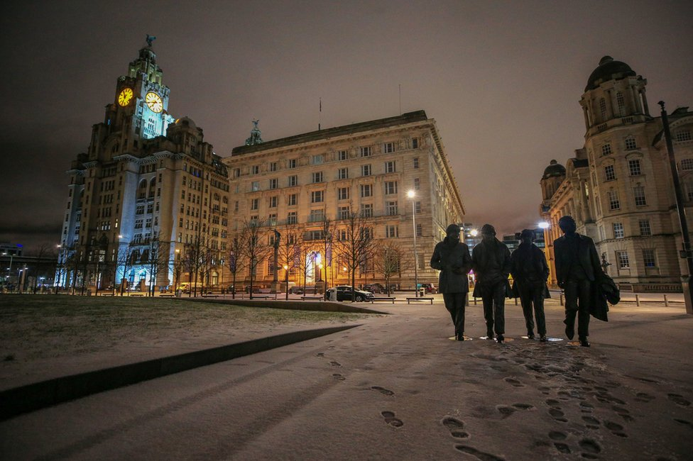 Overnight snow surrounds the statue of the Beatles in Liverpool