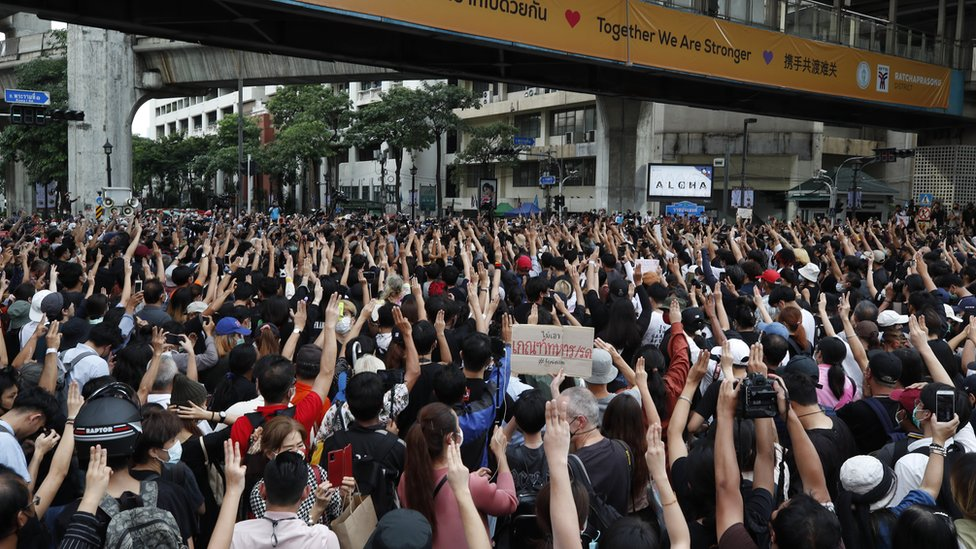 Pro-democracy protesters flash the three-finger salute during a rally against the state of emergency at Ratchaprasong district in Bangkok, Thailand, 15 October 2020.