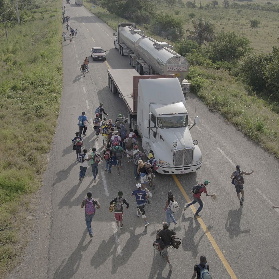 People are seen on a road