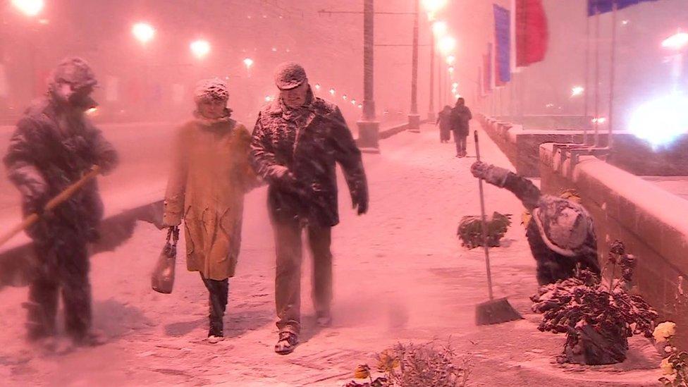 Guards look over a shrine for Boris Nemtsov