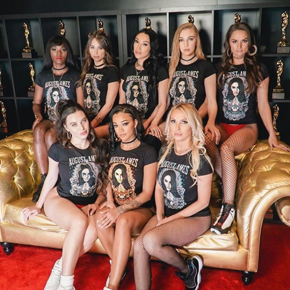 Adult performers wearing August Ames commemorative t-shirts