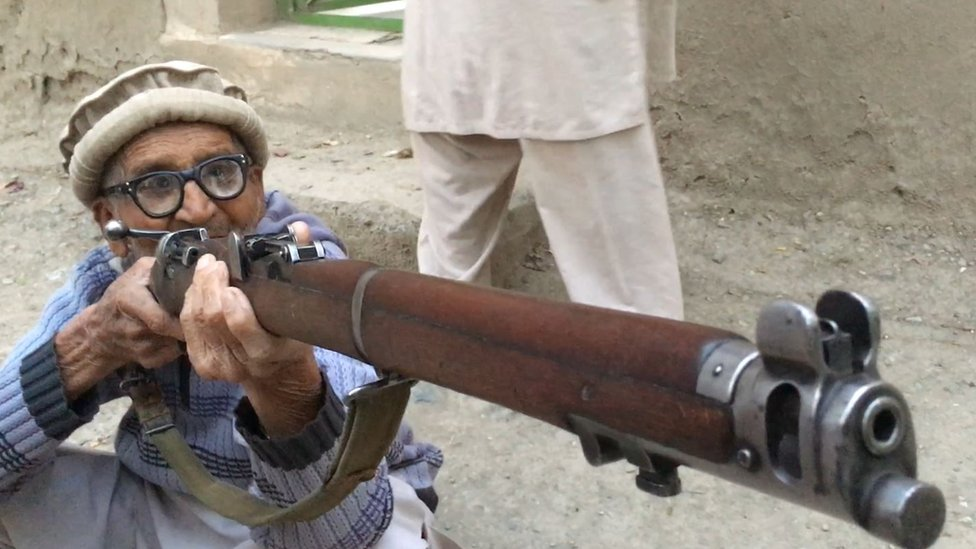 Hussain Gul holds the rifle he used in the battle for Pandu ridge