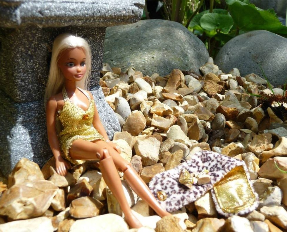 Pippa doll posing in sparkly gold outfit