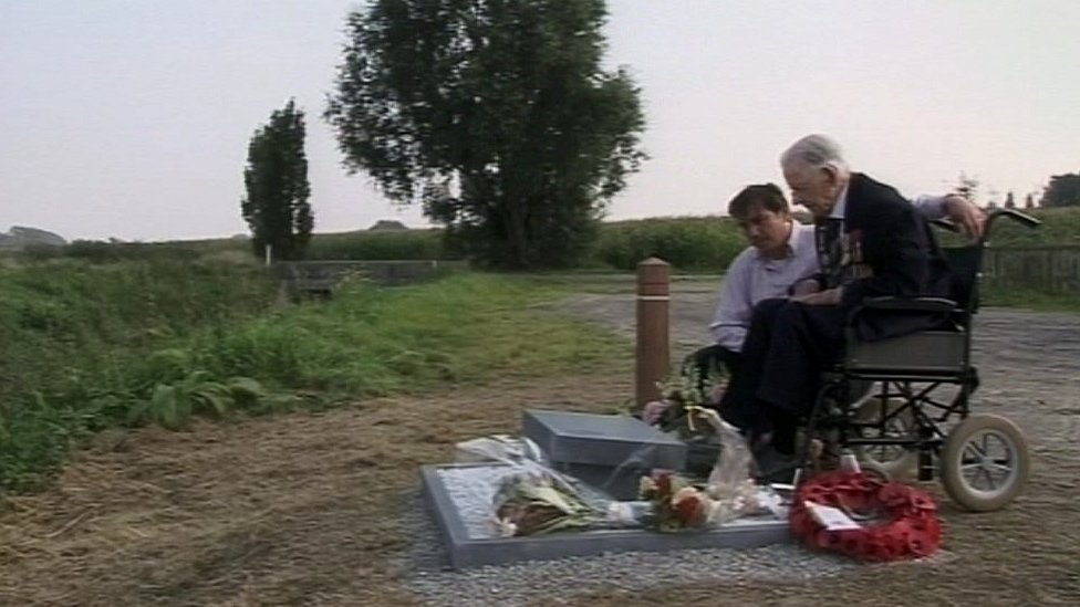 Harry Patch looking at the stone