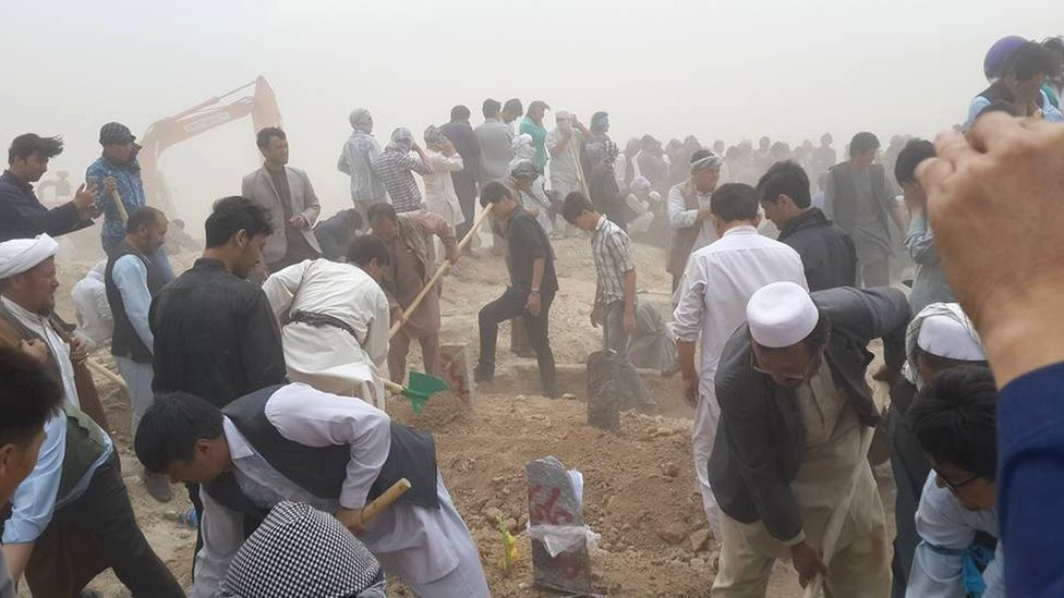 Graves are dug in Kabul, 24 July