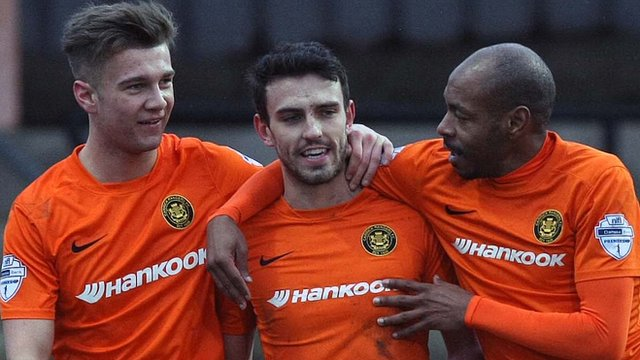 Carrick Rangers players celebrate a 2-1 victory over Coleraine