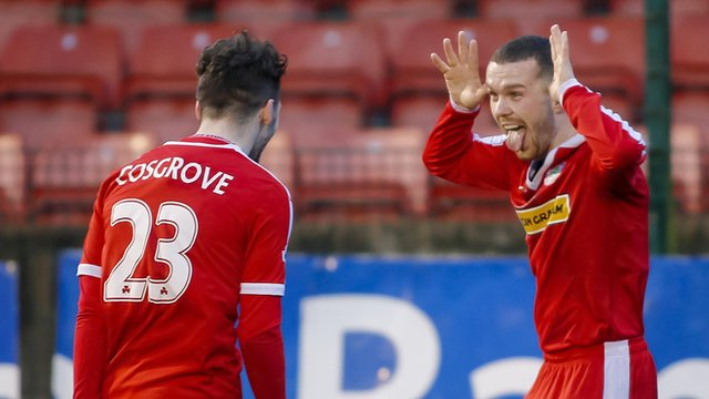 Tomas Cosgrove celebrates with team-mate Martin Donnelly as Cliftonville beat Dungannon Swifts