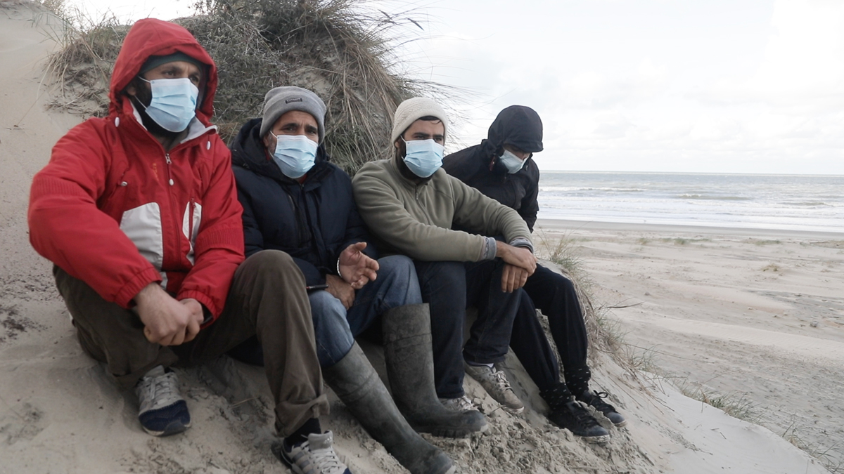 Ebrahim Mohammadpour (second from left) with other survivors from the boat, Loon Plage, France