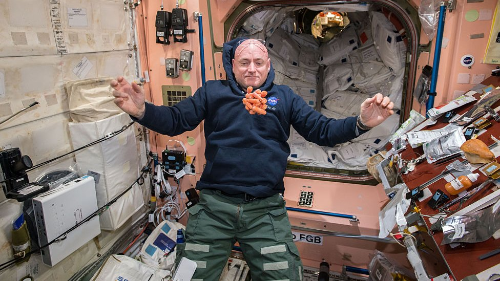 Astronaut eating carrots in space