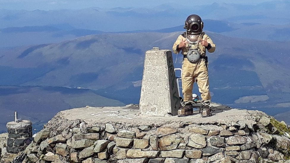 Diver on summit of Ben Nevis