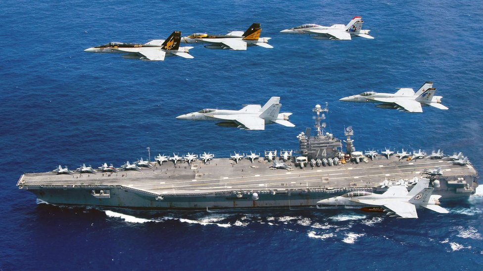 US Navy photo handout taken on 18 June 2016, showing a flight formation of Boeing F/A-18E and F Super Hornets from Carrier Air Wing (CVW) 5 and 9 above the Nimitz-class aircraft carrier USS John C. Stennis (CVN-74) in the Philippine Sea.