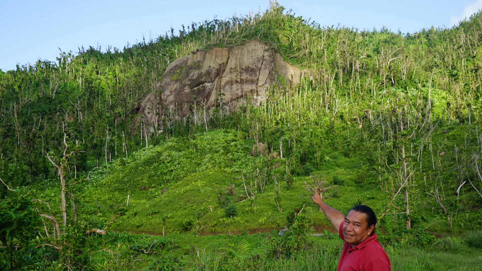 Former Kalinago Chief Irvince Nanichi Auguiste points at White Horse Rock